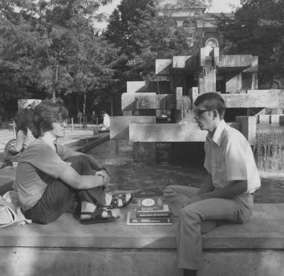 Students talk at the fountain located in front of the Patterson Office Tower