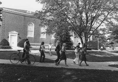 Students walk along the side of Memorial Hall