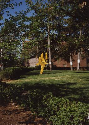 Sculpture beside Wendt Machine Shop on right and an engineering building (part of the