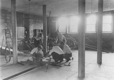 Men working on a chassis for farm equipment