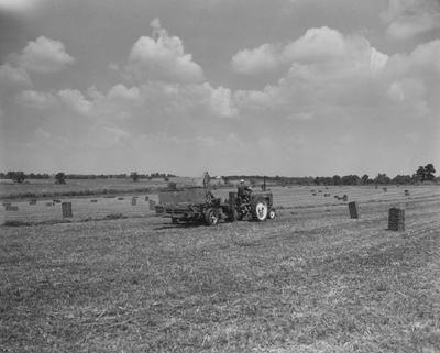 Farmer baling hay