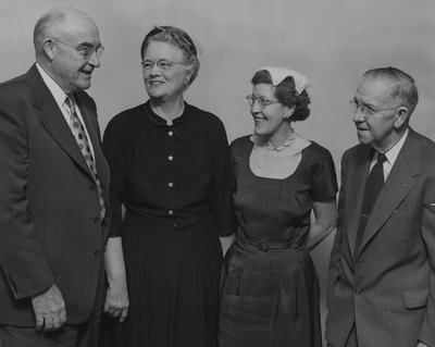 Receiving awards for meritorious service to agriculture during the recent annual extension workers' conference at the University of Kentucky, Lexington, are from left: James E. Humphrey, University of Kentucky field agent in poultry; Helen M. White, assistant state leader of home demonstration agents; Dorothy Threlkeld, field agent in home economics; and Samuel A. Portert, Campbell County agent; Awards were made by Epsilon Sigma Phi national honorary extension fraternity; Received 1959, June 13 from Cincinnati Enquirer
