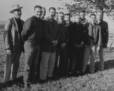 From left to right: Coach Robert W. Hicks, William Glenn Luce, Robert Bennett, Gene Cravens, Oliver Deaton, Bill Cisney, Russell Bingham, Robert Berry, Bob Garrigus, Charles Gray, and Bob Wade