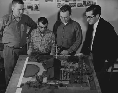 Discussing a residential landscape design model built by C. S. Buster and E. L. Westerfield are, from the left: Curtis Adams, London; Edward Donovan, Boone, Iowa; Lawrence Lose, Louisville; and Dr. J. W. Abernathie, assistant professor of horticulture and teacher of a class in landscape design