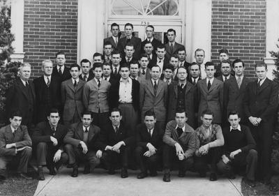 Dairy Club; From left to right, Row 1: Kelly, Price, Kells, Russell, Brown, Browder, Ison, Goodpaster; Row 2: Professor F. Ely, Professor Barkman, Cowgill, Thompson, Stamper, Professor Morrison, Beers, Clore, Petters, Hardesty; Row 3: Hill, Carpenter, Hixon, Campbell, Barnett, Porter, Stapleton; Row 4: Hensley, Routen, Lewis, Colemann, Piper, Cobb; Row 5: Bryan, Phillips, Brandon, Marker, Wright; Row 6: Click, Reynolds, Colliver, Farris; This photo is in the 1941 Kentuckian on page 73