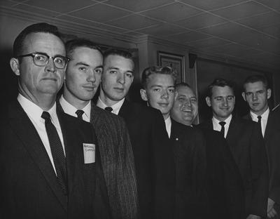 Five University of Kentucky students in the Department of Dairy Science are given $100 scholarships from the dairy industry at a meeting in Lexington of industry representatives and college personnel; From left to right: Marshall Carpenter, manager of the Kentucky Artificial Breeding Association; Jerry Bruce, Bremen; Melvin Cox, Campbellsville; John Peters, Lily; Carl Shearer, president of the Dairy Products Association of Kentucky; E. A. Green, Bridgeport; and Berks Brown, Russellville