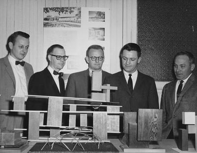 Samples of student work hold attention of University of Kentucky architecture faculty members who will participate the American Institute of Architects' Great Lakes regional meeting at the University of Kentucky and in downtown Lexington; From left to right: J. Quintin Biagi, Dr. James P. Noffsinger, Jasper D. Ward, and Donald Q. Wallace; All but Dr. Noffsinger are part - time instructors from central Kentucky architectural firms