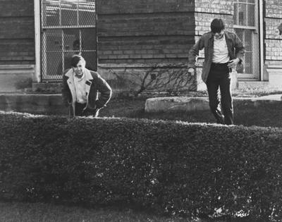 Architecture students outside Pence Hall; This image is in the 1969 Kentuckian on page 395, image number 1