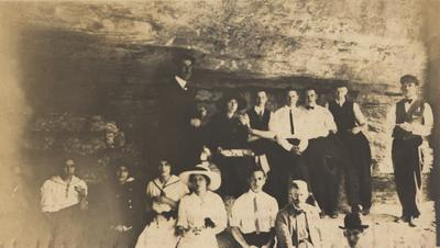 A party at the mouth of a cave while on an excursion to High Bridge