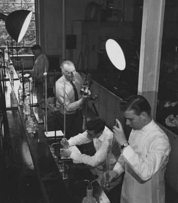 Charles Chapman, producer, in Chemistry lab; One of the scenes from the film