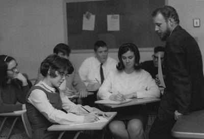Professor Lee Pennington observes his students