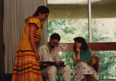 Tony Houston (center) judges a female student at the Foreign Language Festival, which was held in the Student Center on the University of Kentucky campus