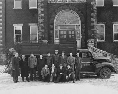 Men in front of the Natural Science building; From left to right, Row 1: Ben Ploch, E. Boyne Wood, John Walsh, Jack Blirdt; Row 2: Samuel Stith, Dan J. Jones, David Young, Everett O'Connell, Joseph Wetherill, A. C. McFarlan, A. Edwin Pettit, ? White, Arnold C. Mason; This image is in the 1941 Kentuckian on page 98
