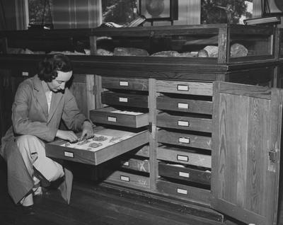 A woman examining rock samples