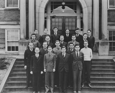 Members of Sigma Pi Sigma, the honorary Physics fraternity; Row 1: Ramsey, Padgett, Hahn, Steedly; Row 2: Pauls, Todd, Penna, Navarre, Robertson; Row 3: Mahan, Koppius, Mayes, Owens, Bowen; Row 4: Cochran, Nelson, Collins, Adams, Flanary, Proctor; Photographer: Lafayette Studio; This image is in the 1941 Kentuckian on page 99