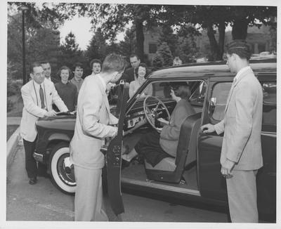 Professor R. D. McIntyre (in front of car)