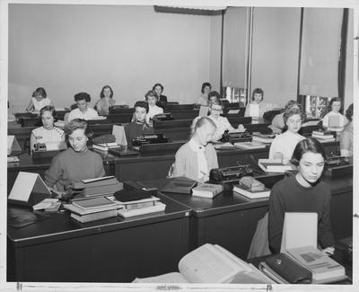 Women in a typing class; Willa Tussey, left front