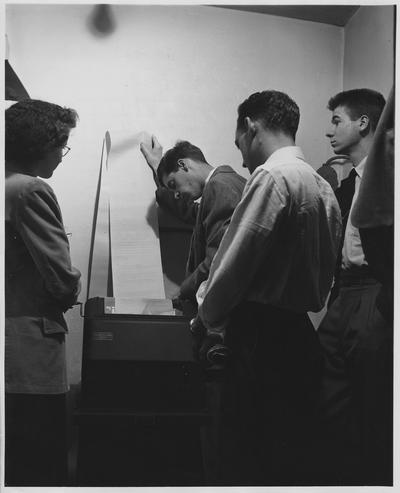 Student journalists providing teletype news services; Photographer: Thomas V. Miller, Jr