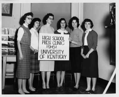 Women hold a sign reading
