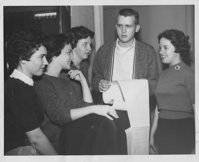 University of Kentucky journalism scholarship holders look over teletype copy; From left to right, with the names of the papers providing the scholarships in parenthesis: Beverly Cardwell, Brooklyn, Kentucky (The Courier - Journal); Kay Barnett, Paducah (The Paducah Sun Democrat); Michele Fearing, Ashland (The Ashland Independent); Eldon Phillips, Lexington (The Lexington Herald - Leader); and Sandra Sue Parham, Wickliffe (Courier - Journal)