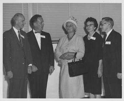 Dr. Willard, Director of the Medical school (far left) with several unidentified people at the dental School opening