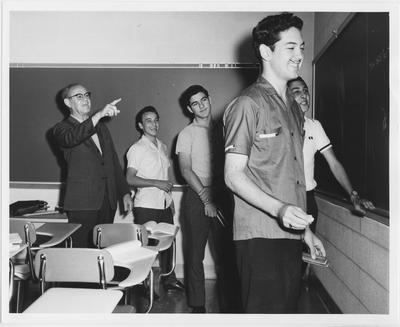 Students from Monterrey, Mexico in a classroom with a professor
