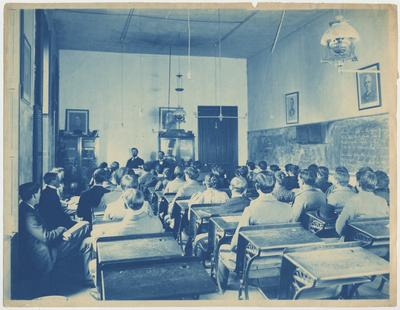 Students sit in a class listening to the professor