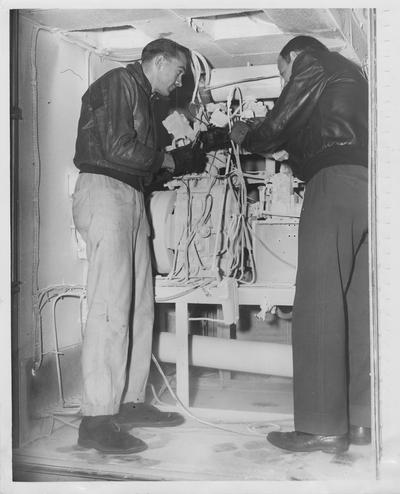 Jean C. Fanney , University of Kentucky student mechanic, and Vivian C, Curreny, research technician, both of Lexington, in University of Kentucky's aeronautical research laboratory located in Wenner - Gren Building