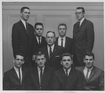 Initiates of the Phi Tau Sigma mechanical engineering fraternity at the University of Kentucky are honored with a dinner at the Lafayette Hotel; From left to right seated: Joseph Miller, Charles Buschman, Ted Bondon, and James Fischer; Center back is Harry S. Traynove, and honorary initiate of the group; From left to right standing: Gerald Dapper, Richard Edwards, Roger Jackson, and William Arrington; Lexington Herald - Leader staff photo