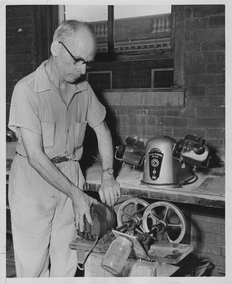 Thomas A. Kendall, research analyst in the University of Kentucky's Department of Mining and Metallurgical Engineering, with two of the