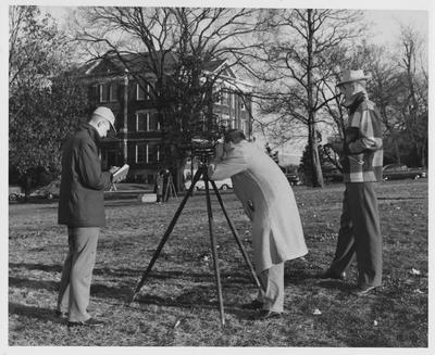 Men surveying