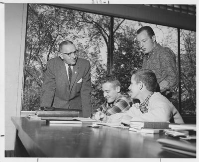 Men studying; This image is on page 299 of the 1963 Kentuckian