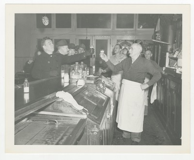 Otto Pop Gruner, owner of the Main Spring Bar having a beer with one of his customers