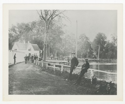 Sam Lee [center, foreground] in front of first swimming pool at Woodland Park
