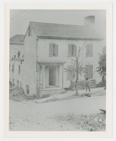 Old house on Tucker Street was at rear of the Main Street Baptist Church which faced the Robert S. Todd home