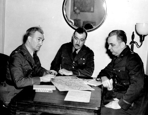 Three National Guardsmen at a table