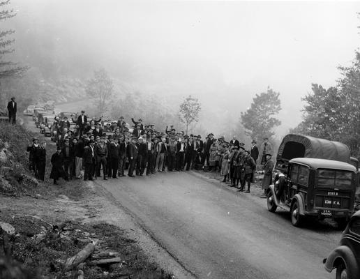 A crowd of miners blocking a road