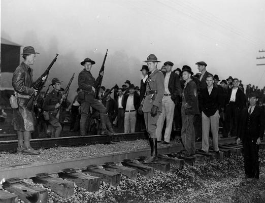 Troops confronting miners on a railroad track