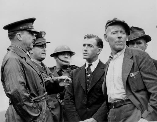 National Guardsmen and civilians talking