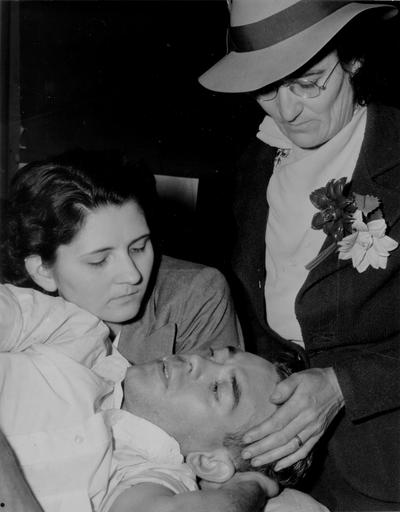 Two women with an injured man