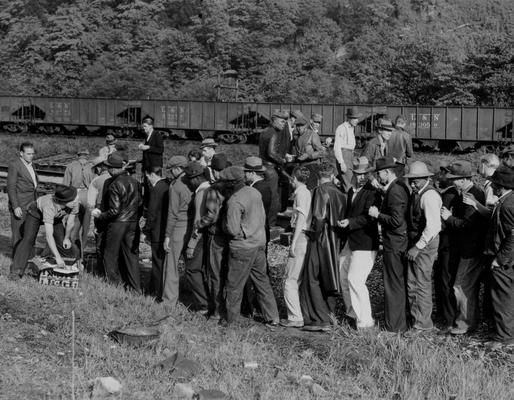 A crowd of miners lined up to pick up lunch