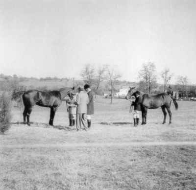 Men and two horses