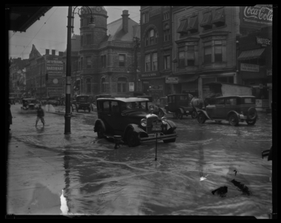 Flood Views; Main Street ; Storefronts in background; Postal                             Telegraph-Cable Company, 205 East Main; Morris Shoe Repairing, 209 East                             Main; Johns Drug Company, 203 East Main