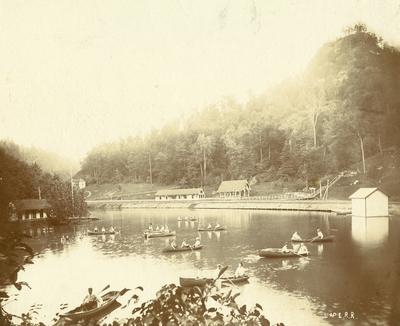 Vacationers at Camp Natural Bridge in rowboats on lake; natural Bridge, Kentucky