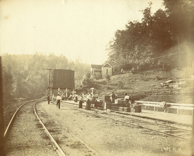 Train station at Natural Bridge, Kentucky; Lexington and Eastern Railway; passengers with luggage waiting for train