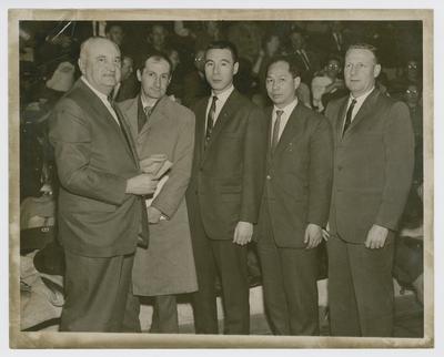 Adolph Rupp, Samim Gorec, Hiorshi Saito, Shiro Yoshii, and Jerry Gray