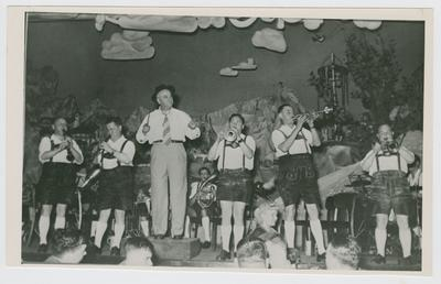 Adolph Rupp leading a band in Germany