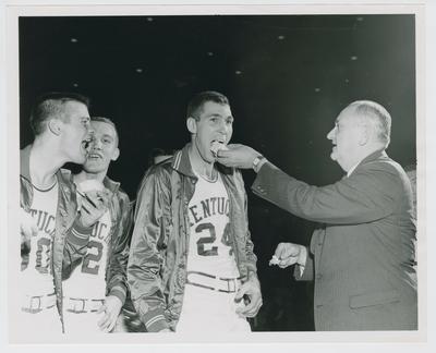 Bennie Coffman, Al Robinson, Johnny Cox, and Adolph Rupp