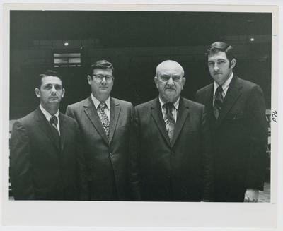 UK Coaching Staff: Dickie Parsons, Joe B. Hall, Adolph Rupp, and Gale Catlett