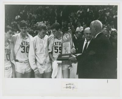 UK vs. Texas Western: Louie Dampier, Tommy Kron, Larry Conley, Thad Jaracz, Adolph Rupp, and Bernie Shively receive 2nd place trophy